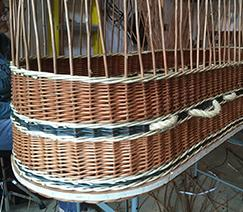 Turning the border down on a willow coffin